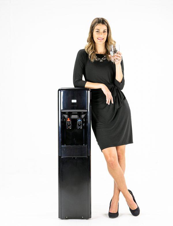 Woman leaning on an Evererst bottleless water cooler