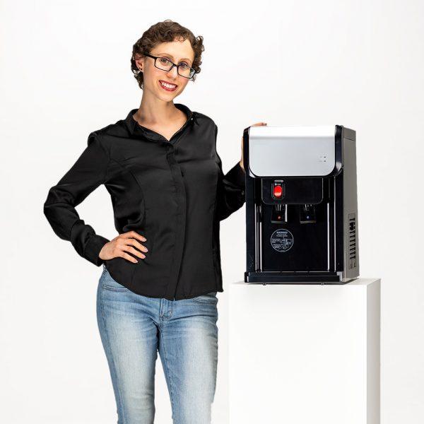 woman next to mini bottleless cooler